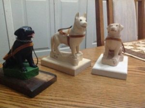 Wood Carvings of standing German Shepard Dog and Labrador in Natural wood with harness, collar and leash.created by artist Ron Davidson mobile: 316-516-3390 email: davidsonron65@gmail.com